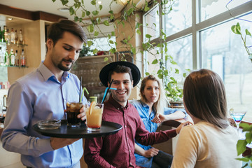 Young People In A Restaurant