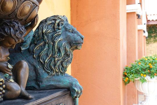 Bronze lion statue, selective focus, lion is looking away