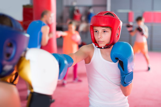 Boys and girl practicing boxing punches