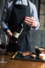 Man holding red wine bottle