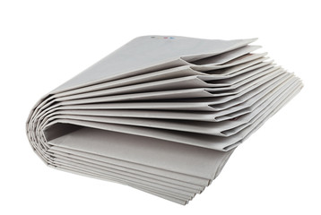 Folded newspapers isolated on white background.