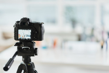 Professional camcorder in apartment of blogger