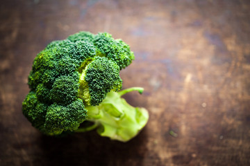 Fresh broccoli  on wooden table close up. Healthy Green Organic Raw Broccoli Florets
