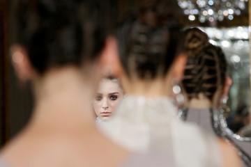 Models present creations by Italian designer Antonio Grimaldi in Paris