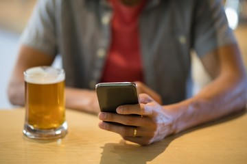 Man using mobile phone in restaurant