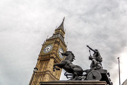 Statue of Boudicca with chariot and horses, near Westminster, Big Ben and the Houses of Parliament. London
