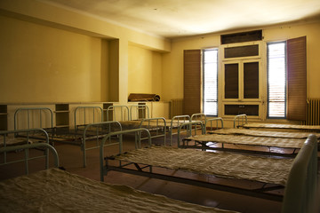 Beds in an abandoned room