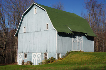 Blue Barn: A large wooden barn wears a subtle shade of blue on an autumn afternoon in Pennsylvania.