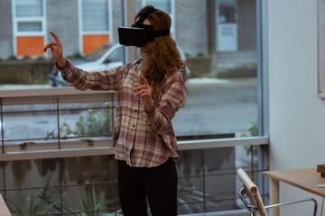 Female executive using virtual reality headset