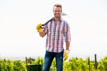 Portrait of smiling man holding shovel