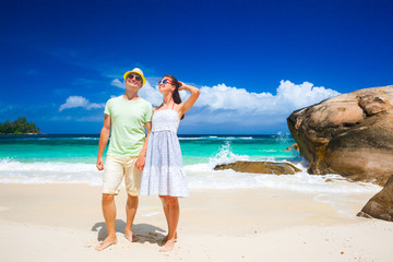 happy young couple having fun by the beach. Seychelles. Mahe Island. Baie Lazare beach