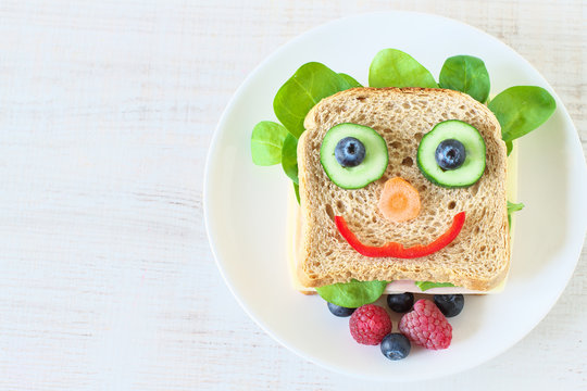 Healthy and fun food for kids , happy and funny face sandwich