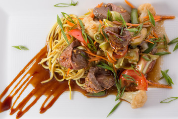 meat with noodles and vegetables