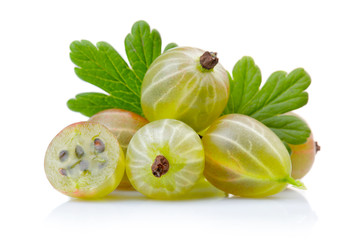 Ripe green gooseberries with leaves isolated on white