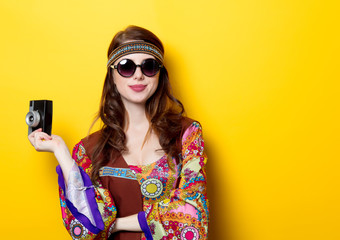 Young hippie girl with sunglasses and camera