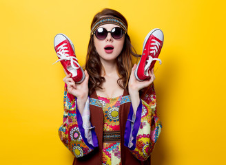 Young hippie girl with red gumshoes