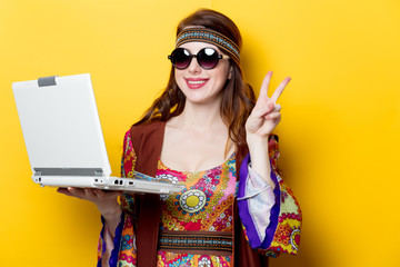 Young hippie girl with white laptop