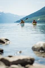 Surface level of couple kayaking in lake