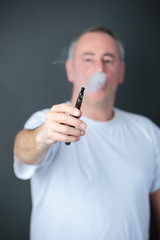 man smokes electronic cigarette