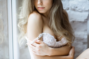 Female portrait of cute lady in white bra indoors