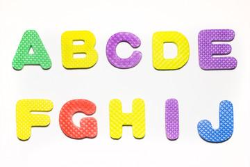 Sponge rubber alphabet colorful font style.