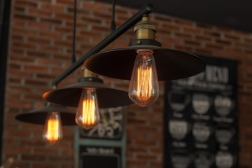 Vintage interior lighting lamp in coffee shop.