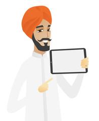 Hindu businessman holding tablet computer.