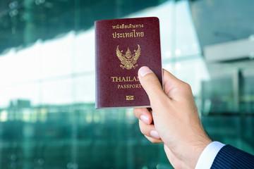 Businessman hand showing passport