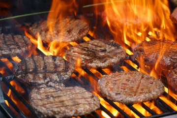 barbecue grill cooking burger steak on the fire