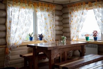 Interior cafe in russian rustic small hut with windows