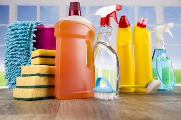 Close up of cleaning supplies and equipment and window background