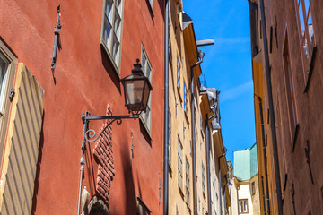 Old house facade with street light. Gamla stan