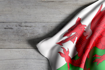 Wales flag on wooden surface