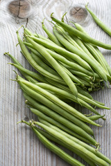 Pile of fresh beans on the wooden background
