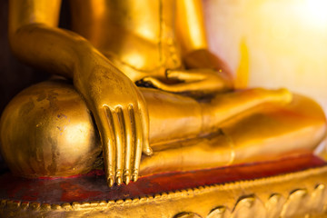 Golden color hand of image of Buddha in old temple of Thailand