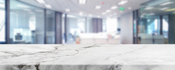 White marble stone tabletop and blurred bokeh office interior space background - can used for display or montage your products.