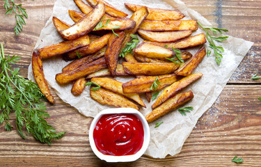 Home fries on wooden background