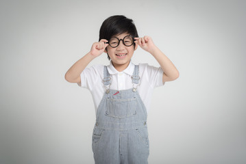 Happy Asian child wearing glasses smiling