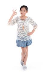 Cute asian girl in summer dress showing ok sign