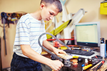 Child in the workshop working tool