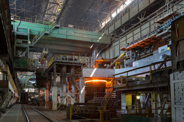 Smelting steels in heavy industry factory.