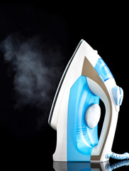 Steam iron on a black background