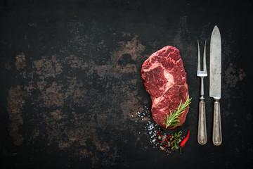Raw dry aged beef ribeye steak
