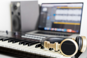 Home Music computer studio with golden headphone