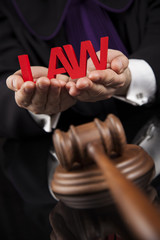 Law theme, mallet of the judge, scales of justice