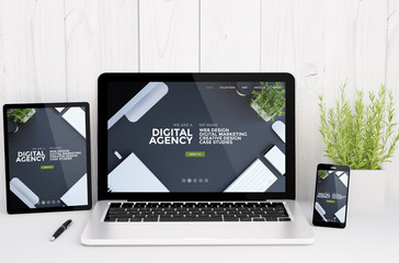 Wall Mural - devices on table with digital agency, responsive design