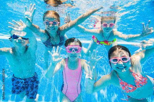 little kids swimming in pool underwater - Kids Swimming Underwater