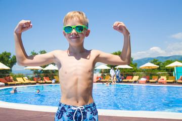little boy near swimming  pool