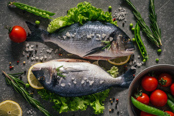 Flat lay of tasty dorado fish with vegetables and spices