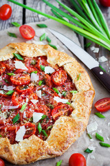 Delicious homemade rustic open pie (galette) with tomato, cheese and onion